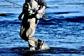 Fly fishing tricks. Wading in water.