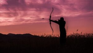 Archery glossary. Recurve archer in field.