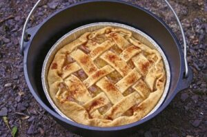 Camping Dutch oven apple pie.