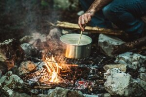 Tip for campfire cooking. Stirring pot cooking.