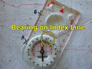 Compass bearing on map with index line.