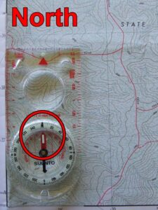 Orientate map and compass to north..