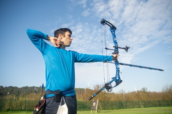 Compound bow list.Man shooting target bow.