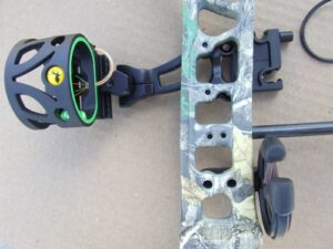 Compound bow riser and bow sight.