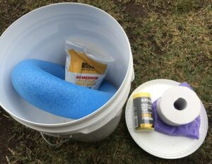 DIY homemade toilet bucket with tp and bags.