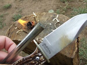 Fire lighting ferro rod with the Uncle Henry Bowie