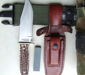 Uncle Henry Bowie knife sheath and sharpening stone.