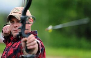 what is the fastest shooting compound bow? Male releasing arrow.