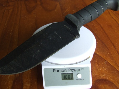 Ka=Bar Warthog fixed blade on scales for weight