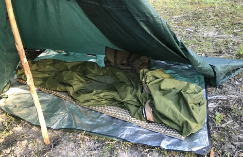 Sleeping bag in bivvy bag and sleeping matyt to