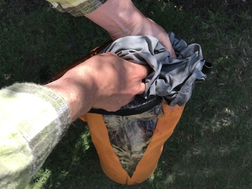 Bushcraft dry bag uses washing clothes in dry bag.