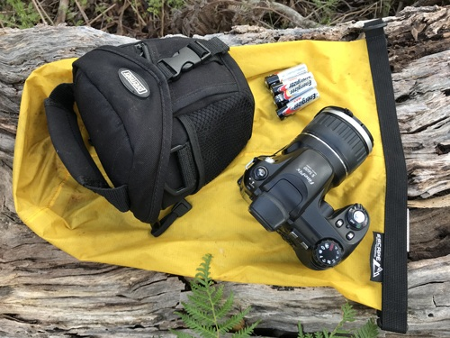 Bushcraft uses dry bag for storing electronic gear.