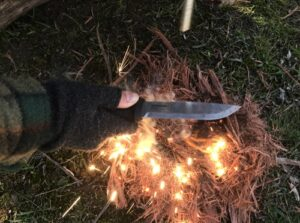 Mora Garberg lighting camp fire with ferro rod..