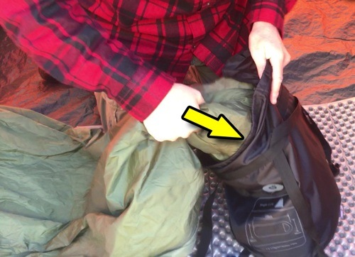 Stuff a sleeping bag when backpacking or camping.