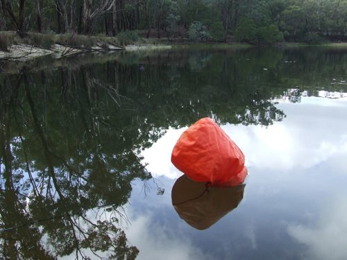 Survival fishing, improvised float with dry bag.