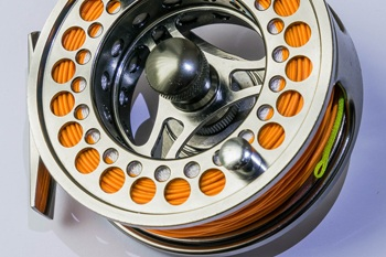 Fly fishing reel with fly line.