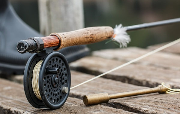 Fly fishing questions. fly rod on pier.